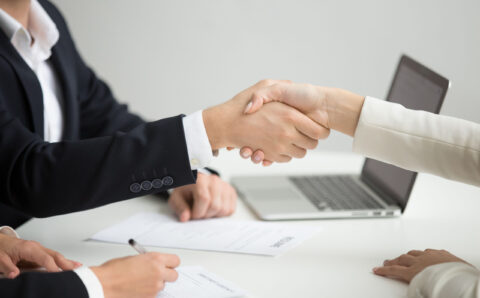 Hr handshaking successful candidate getting hired at new job, cl