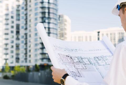 close-up-man-looking-at-building-design