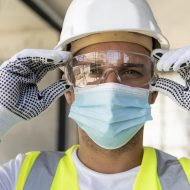 worker-wearing-safety-glasses-on-a-construction-site